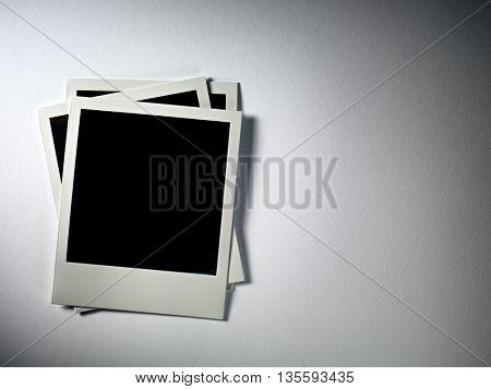 KYIV, UKRAINE - FEB 08, 2014: Polaroid photo cards on white.