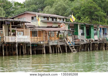 Brunei's Famed water village Kampong Ayer in Bandar Seri Begawan, Brunei on Villages are fully self sufficient with their own water, shops. poster