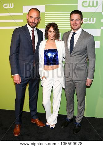 NEW YORK, NY - MAY 14: (L-R) Actors Paul Blackthorne, Willa Holland and Stephen Amell attend the 2015 CW Network Upfront Presentation at the London Hotel on May 14, 2015 in New York City.