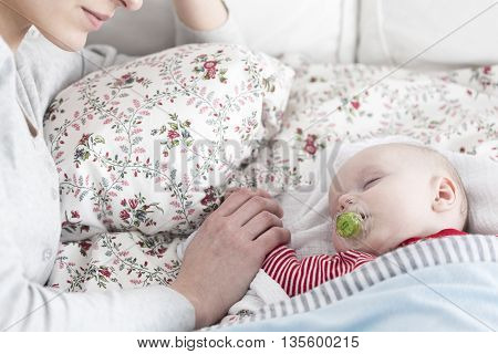 Sleeping Baby And Careful Mother