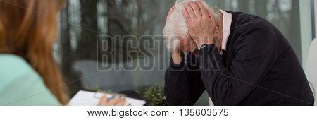 Sad senior at the psychotherapy individual session