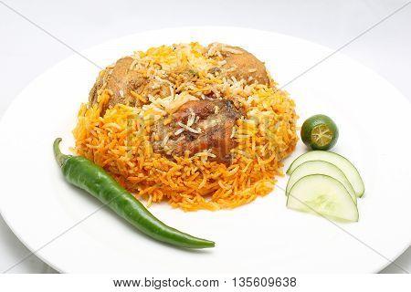 Khichuri lentil rice dish chili lime cucumber on plate white background