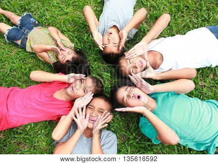 Six kids having good time in the park.