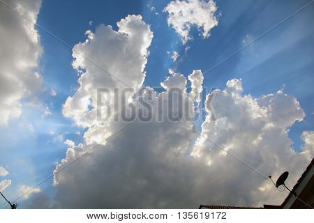 awesome scenery of cloud with a satellite dish facing upwards