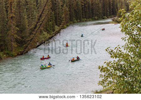 A group of canoes on the Bow River in Banff Alberta