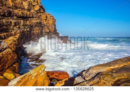 The raging ocean and blue sky in the most well-known point on Earth. Cape of Good Hope, South Africa
