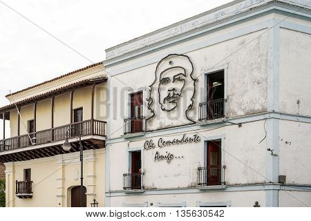 Santiago de Cuba Cuba - January 13 2016: Typical scene of one of streets in the center of Santiago de cuba - Image of Ernesto Che Guevara on house wall. Santiago is the 2nd largest city in Cuba