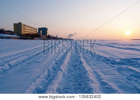Volga river bank in the city of Samara in the winter at sunset