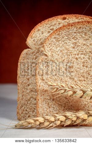 Slices of whole wheat bread and wheat