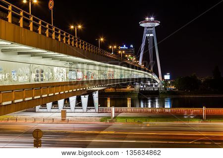 BRATISLAVA SLOVAKIA - 29th April 2016: The UFO Tower and Novy Most Bridge at night. The UFO Tower offers high views of the city