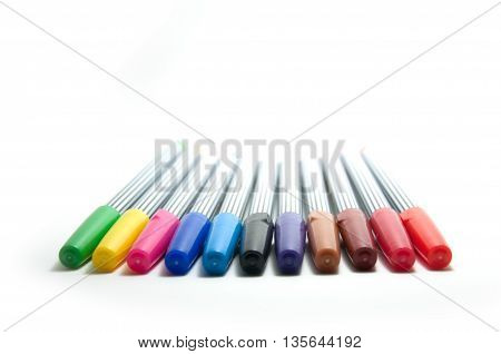 Closed up rainbow of soft-tip pen isolated on white