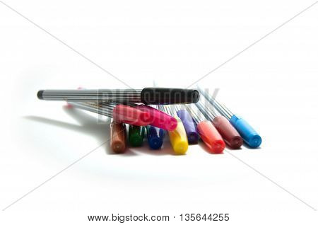 Different soft-tip pens on a white background