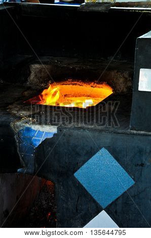 Traditional brick kiln with fire ready to cook