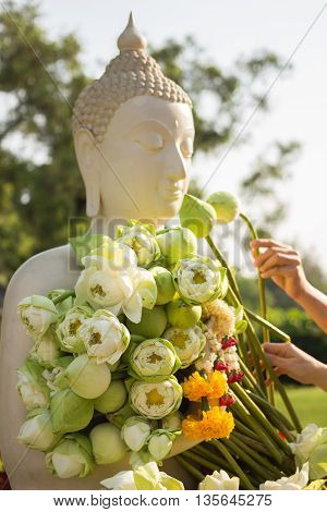 afternoon, ancient, art, asia, asian, background, buddha, buddhism, buddhist, close, color, culture, detail, east, faith, finger, flower, garland, god, hand, lily, lotus, marigold, meditate, meditation, nature, offer, old, oriental, outdoor, peace, peacef