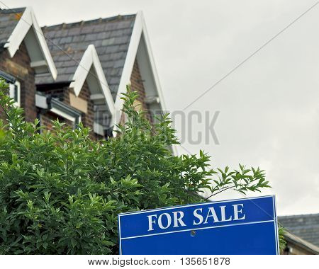 Property For Sale sign outside of  houses