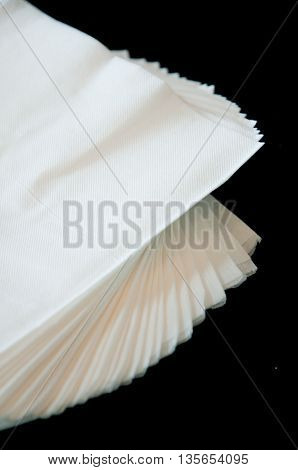 Closeup of a stack of paper napkins on top of a table