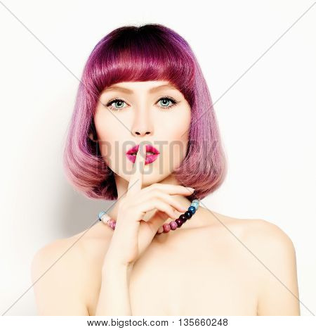 Attractive Young Woman with her Finger on her Lips. Girl Shushing