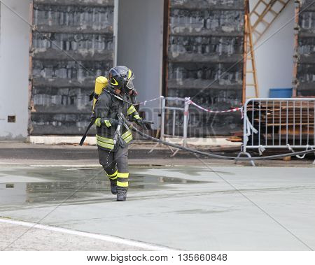 Firefighters With Breathing Apparatus And Oxygen Cylinder Runs