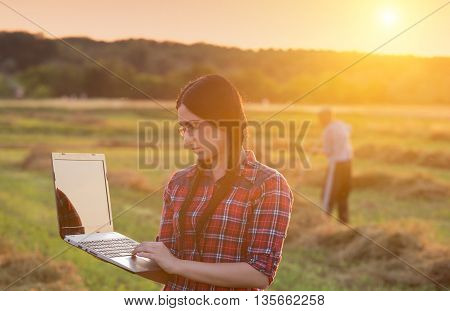 Farmer Girl With Laptop On Ranch