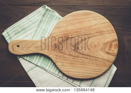 old cutting board and dishcloth on the wooden table