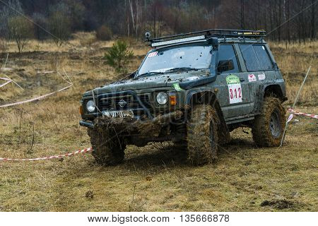 Lviv Ukraine - February 21 2016: Off-road vehicle brand Nissan (No. 312) overcomes the track on a amateur competitions Trial near the city Lviv Ukraine