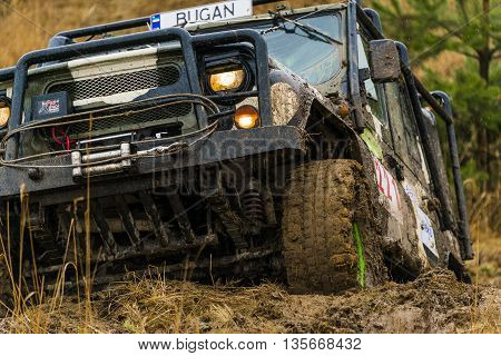 Lviv Ukraine - February 21 2016: Off-road vehicle UAZ (No. 221) overcomes the track on of landfill near the city Lviv.
