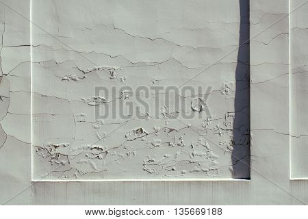 Texture of old weathered concrete gray wall with cracked dirty fissure plaster abstract grunge background closeup