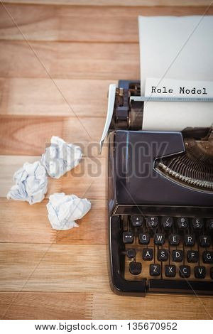 Role model message against typewriter with crumpled paper on table in office