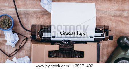Word gracias papa against above view of typewriter and old phone