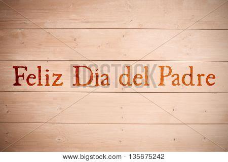 Word Feliz dia del padre against wooden planks