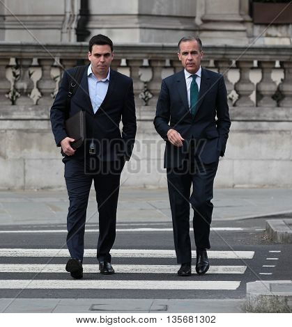 LONDON , UK - MAY 15, 2016: Mark Carney Governor of the Bank of England seen arriving for the BBC Andrew Marr show picture taken from the street