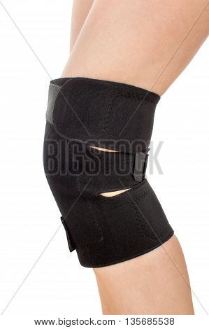 Closeup of woman leg with knee braces isolated on white