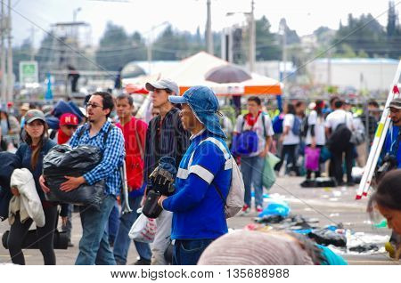 QUITO, ECUADOR - JULY 7, 2015: Several focus on men, garbage cleaner after pope Francisco mass event in Quito.
