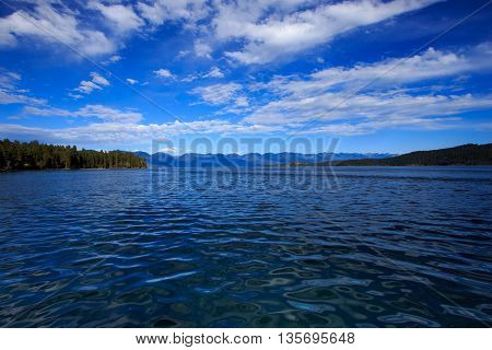 Landscape of Flathead Lake in Montana with water and mountains.