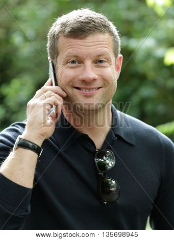 LONDON, UK, JUN 15, 2015: Dermot O'Leary attends the Burberry Prorsum fashion show for LFW picture taken from the street
