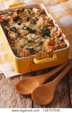 Strata Casserole With Spinach, Cheese And Bread Close Up. Vertical