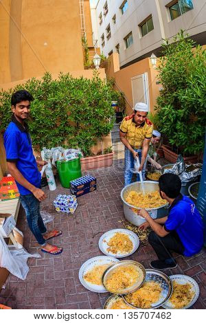 dubai, June 14, 2016: iftar dinner is prepared by volunteers near a mosque in Bur Dubai, UAE