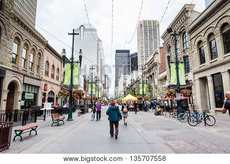 CALGARY, CANADA - JUNE 18: Tourists and Calgarians alike stroll along Stephen Avenue Walk June 18, 2016. The area is a National Historical District with over 30 restored buildings that feature architectural styles from the late 1800s to the 1930s.