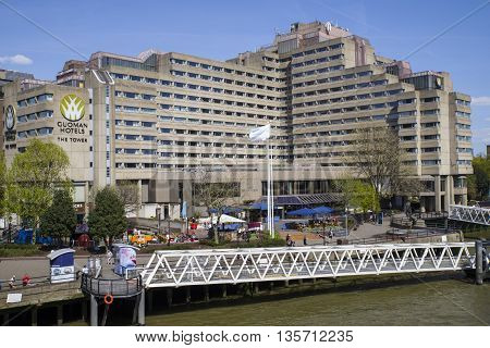LONDON UK - MAY 4TH 2016: The Tower Guoman hotel situated on the north bank of the River Thames in London on 4th May 2016.