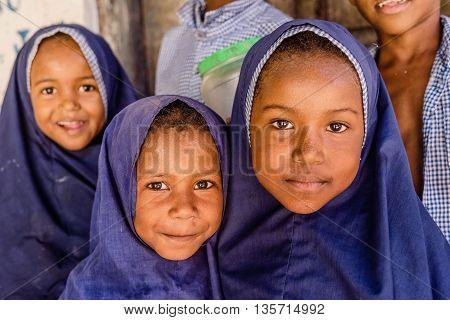 Mobmasa, Kenya- March 16,2016: School children wearing school uniforms  in Mombasa Kenya