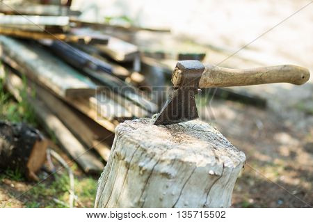 Ax, Hatchet, Axe. Split A Log With An Ax. Birch Firewood In The Background