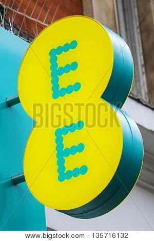LONDON UK - APRIL 7TH 2016: The logo on the exterior of an EE retail store on Oxford Street in London on 7th April 2016.