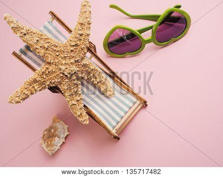 Starfish on a deckchair travel concept image