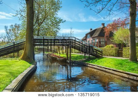Giethoorn: a small village in the Netherlands. Often called Northern venice as central part of it has no car roads and certain houses accessible by boat only