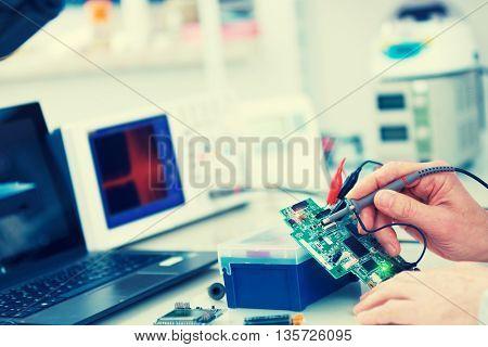 Using the microscope electronics laboratory. Toned photo