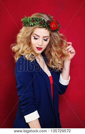 Beautiful Blonde Model with blue jaket on Red Background