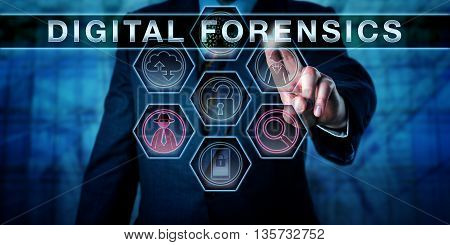 Male cyber crime investigator pressing DIGITAL FORENSICS on an interactive touch screen monitor. Investigative concept for computer forensics network forensics and the electronic discovery process.