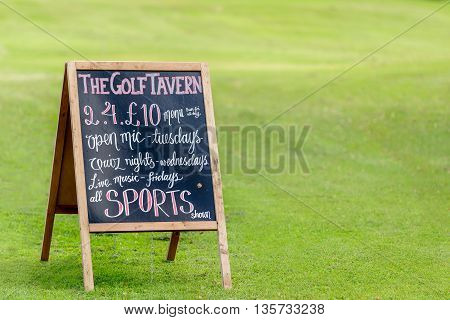 EDINBURGH SCOTLAND - JUNE 20 2016: An advertising board for The Golf Tavern in Edinburgh. The tavern is one of the oldest public houses established in 1456.