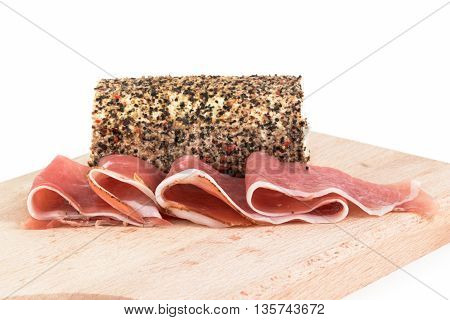 speck and pepper cheese on chopping board