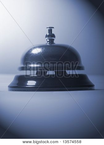 A photo of a bell used to solicit service